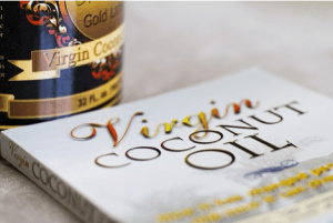photo of coconut oil book and virgin coconut oil jar