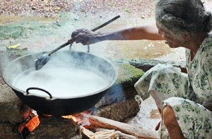 photo of woman making traditional coconut oil
