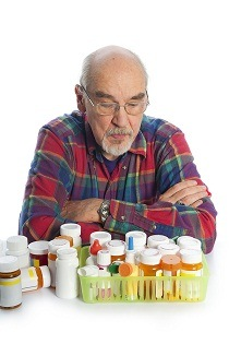 picture of senior with many prescription drugs